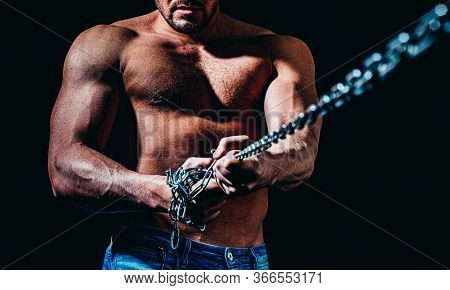 Strong Bodybuilder With Broken Chains, Perfect Abs, Shoulders, Biceps, Triceps And Chest, Deltoid Mu