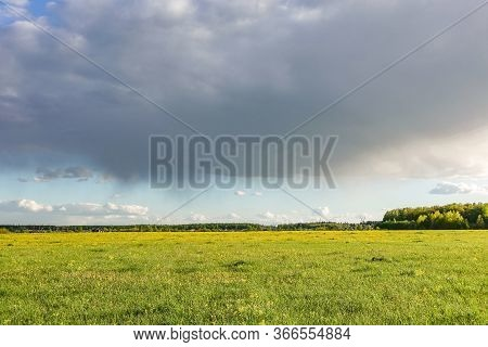Country Landscape. Green Field And Rain Cloud
