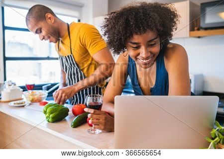 Quarantined Couple Cooking In Kitchen At Home.