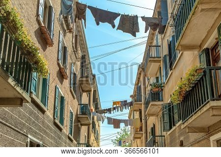 In The Middle Of Venice, Clotheslines With Laundry Are Stretched Between The Rows Of Houses