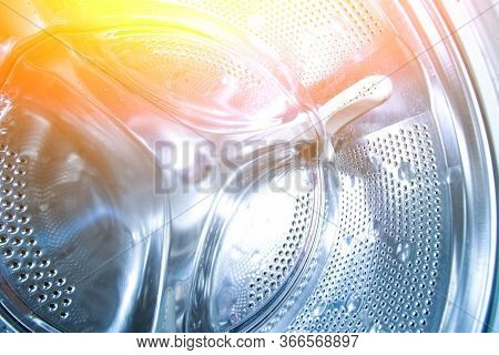 Inside The Drum Of The Washing Machine. Steel Drum Open. Closeup. Washing Machine Drum Background Wi