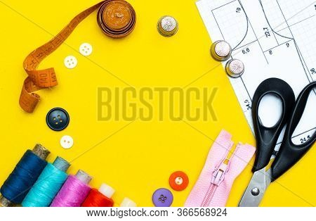 Layout Sewing. Needlework, Craft, Sewing And Tailoring Concept - Box With Thread Spools And Buttons