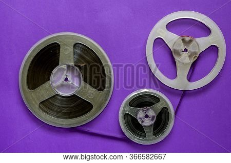 Old Bobbins With Audio Tape. A Group Of Coils With Real Dust And Dirt. Various Bobbins With Family A