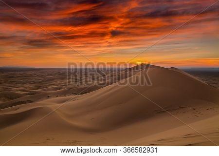 Sunset Over The Sand Dunes In The Desert. Beautiful Landscape Of The Sahara Desert