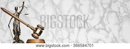 A Gavel And Bronze Themis Statue - Symbol Of Justice - Against A Marble Background