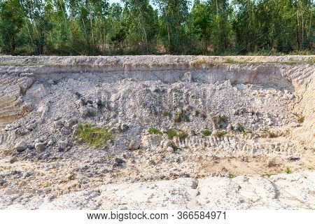 Landslide In An Environmentally Hazardous Area. Large Cracks In Earth, Descent Of Large Layers Of Ea