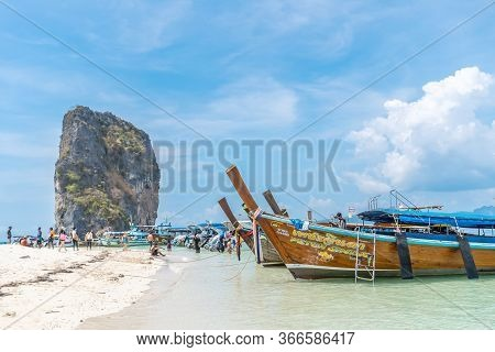 Krabi, Thailand, 15 Feb 2020: People And Long Tail Boats On The Beautiful Sand Beach At Koh Poda Isl