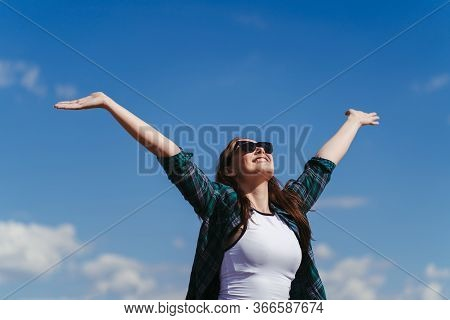 Well Being, Freedom, Success. Happy Woman With Open Arms In The Air. Cheerful Woman Rising Hands To