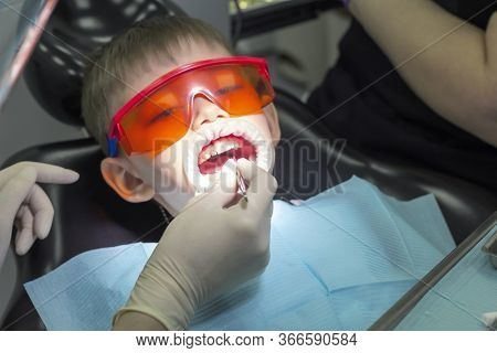 Kids Dentistry. Children\'s Dentist Examination Baby Teeth. Emotions Of A Child In A Dental Chair. L