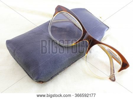 Old Vintage Style Glasses And A Leather Case