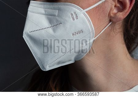 Young woman wearing KN-95 protection medical mask. Prevention of the spread of virus and epidemic, p