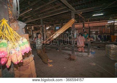 Mandalay Myanmar - November 5 2013; Confectionary Factory With Man Pulling And Stretching Long Strin