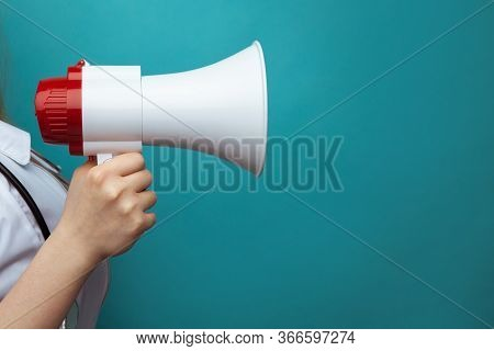 Doctors Advice And Healthcare Announcement Concept With White Lab Coat Holding A Megaphone Isolated