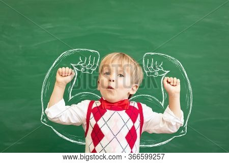 Funny Child Student In Class. Happy Kid Against Green Chalkboard. Physical Education Concept. Back T