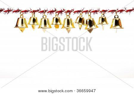 Golden Bell Holding Ribbon Rope On White Background