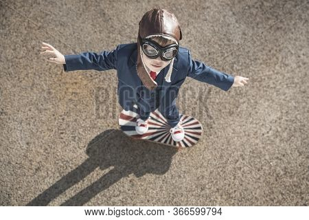 Happy Child Playing With Toy Wings Outdoor