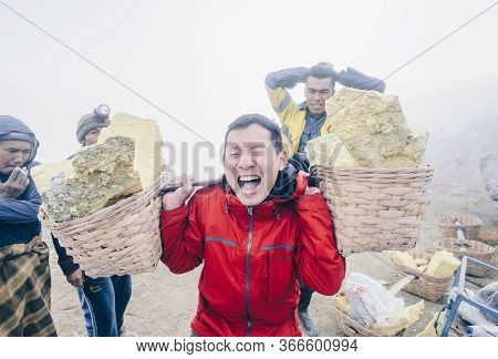 Kawah Ijen, East Java, Indonesia : 17 July 2018 : Asian Tourist Trying To Carrying Sulphur With Mine