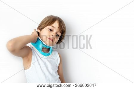Child Complaining Of Neck Pain Wearing A Cervical Collar Support. White Background