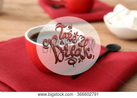 Cup Of Hot Coffe On Table And Text Take A Break