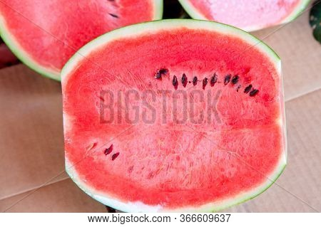 Sweet Water Melon, Some Cut Half. Watermelon At Market. Fresh Organic Watermelons On A Marketplace.