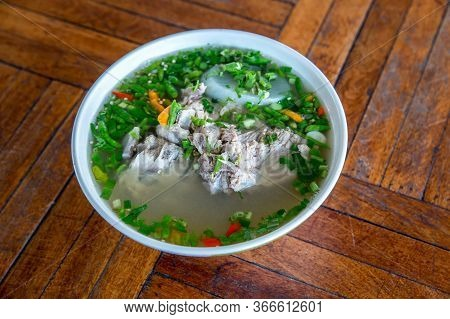 Hot And Spicy Soup With Pork Ribs. Spicy Pork With Pork Bone Soup On The Wood Table. Leng Soup In Th