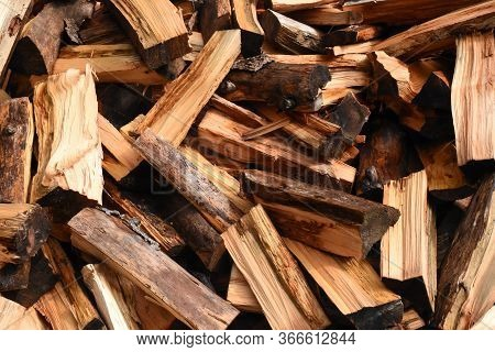 Large Pile Of Fresh Chopped Firewood Ready For Stacking.
