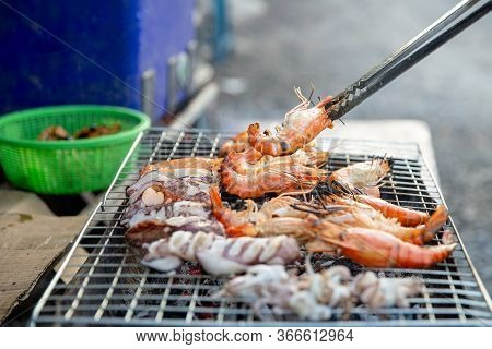 Professional Chef Cooking  Prawns Or Shrimp Grilled On Charcoal Stove. Shrimp Grilled Bbq Seafood On
