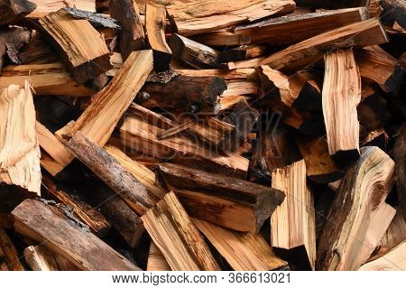 Large Pile Of Firewood Chopped In A Big Pile.