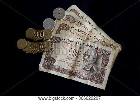 Banknotes And Pesetas Coins On Black Background