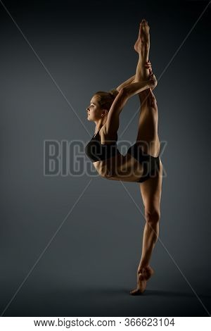 Sport Woman Stretching Twine, Beautiful Gymnast Girl Standing On One Leg And Stretch Gymnastics Exer