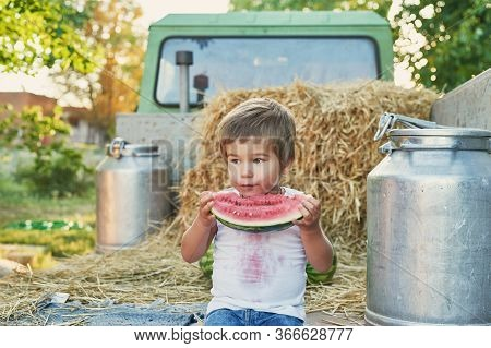Family On Farm.harvesting Watermelons. Pickup With Watermelons.picnic On Farm.family Day.child Boy A