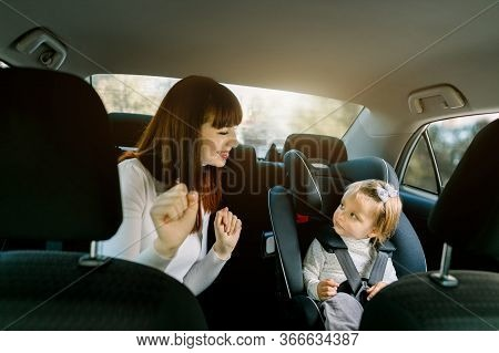 Family, Transport, Road Trip And People Concept - Happy Woman Playing With Her Child Little Cute Bab