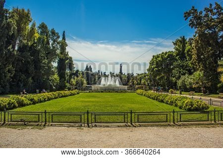 Outdoor Park With Trees And Fontain In Summer Bright Colorful Day