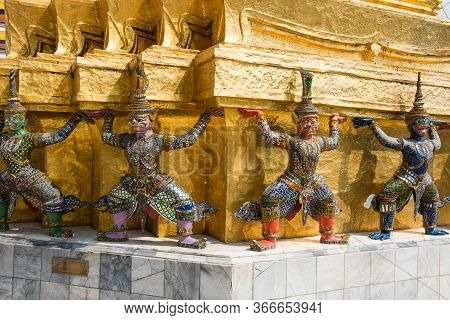 Statues Of Human And Monkey Guards At Golden Chedi In Temple Of Emerald Buddha. Grand Palace Complex