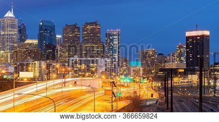 Panorama of Philadelphia skyscraper Skylines building twilight dusk sunset with highway urban road transportation in Philly city downtown of Philadelphia in PA USA. Cityscape Urban lifstyle concept.