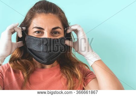 Mature Latin Woman Portrait Wearing Protective Face Mask And Gloves - People Self Quarantine For Pre