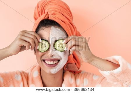Young Woman Having Skin Care Spa Day At Home - Happy Girl Applying Cucumber Facial Cleanser Mask - H