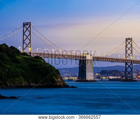Beautiful sunset with Bay bridge and San Francisco Bay landscape in North California USA West Coast of Pacific Ocean, San Francisco United States Landmark Travel Destination cityscape concept.