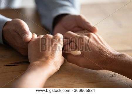 Close Up Elder Woman Giving Hands To Compassionate Husband.
