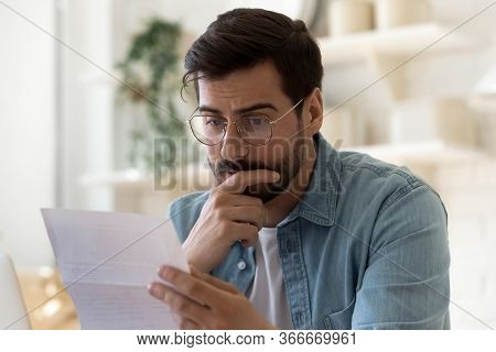 Frustrated Man Read Bad News In Paper Post Letter