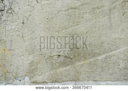 Fragment Of Texture Of Concrete Wall Of Building With Old Cracked Plaster With Damp Moldy Cracks. Ab