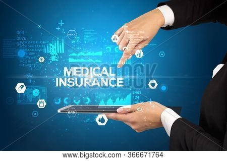 Close-up of a touchscreen with MEDICAL INSURANCE inscription, medical concept