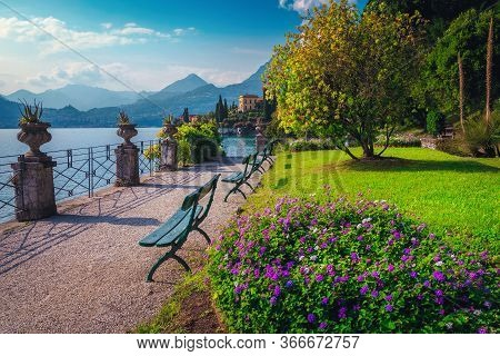 Fantastic Promenade In The Ornamental Garden Of Villa Monastero With Colorful Flowers And Mediterran