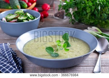 Vegetarian Healthy Soup, Green Peas Cream Soup With Olive Oil On Wooden Table