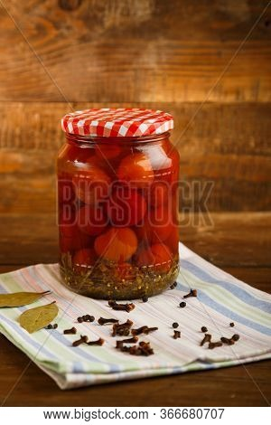 Jars Of Pickled Homemade Pickled Cherry Tomatoes On A Wooden Table.