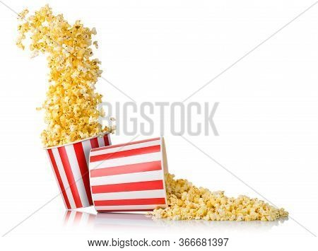 Set Of Flying Popcorn From Paper Bucket And Scattered Popcorn Isolated On White