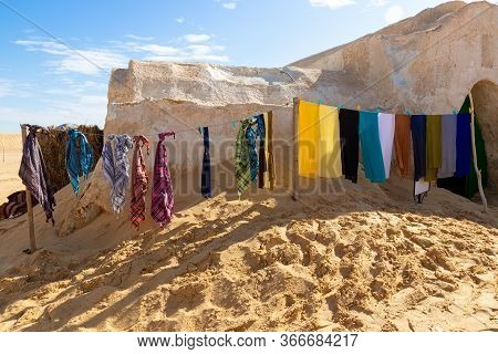 Selling Colorful Berber Scarves And Keffiyeh In The Desert In The Area Of Ong Jemel, Tunisia. Popula