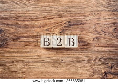 Wooden Building Blocks With The Abbreviation B2b On Textured Wood Background. Business To Business M