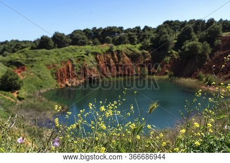 Bauxite Quarry Lake In Otranto, Puglia, Italy. Salento, Otranto: Lunar Landscape Of The Lake Of The