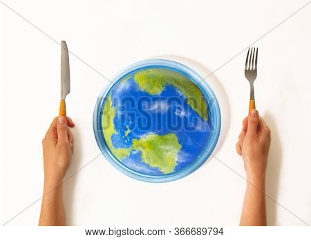 Ready to eat the world on dish using fork concept.